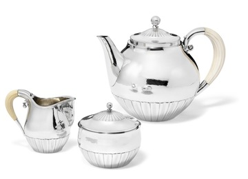 Sterling silver tea set with slightly hammered surface and carved ivory handles.