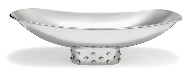Oval sterling silver bread basket on tall oval foot with square relief decor.