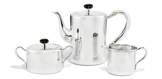 Sterling silver coffee set with ebony finials. Coffeepot with bone spacers.
