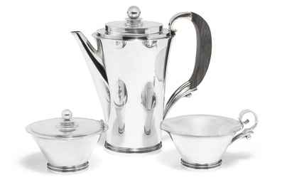 Pyramid. Sterling silver coffee set comprising a coffeepot, a creamer and a sugar bowl with hinged cover. Coffeepot's handle of carved ebony.