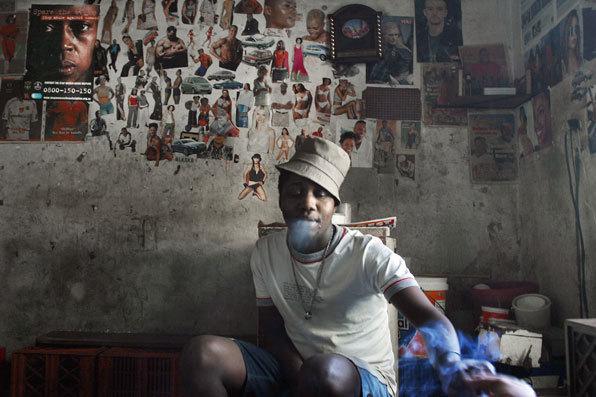 , 'Mbulelo at the bar he runs in a house in Joel Road, Berea,' 2004, Kuckei + Kuckei