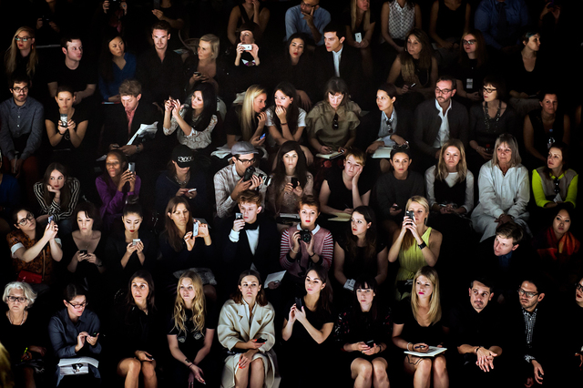 , 'A crowd of attendees watches the Issey Miyake runway show at Paris Fashion Week, Spring 2014.,' 2014, Anastasia Photo