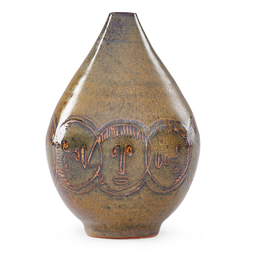 Small early vase with faces
