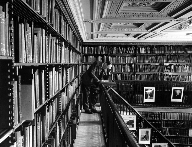 , 'Man reading book among shelves on balcony in American History Room of the New York Public Library, NY,' 1944, Robert Mann Gallery