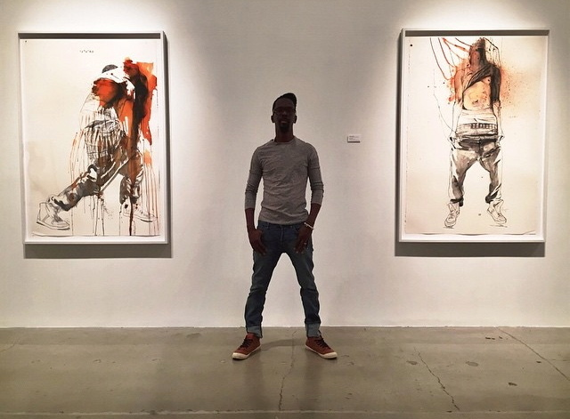 "Artist Fahamu Pecou (standing) ""Teth'rd"" (left) and ""Lifted"" (right) ""GRAV-I-TY"" installation at MOCAGA"