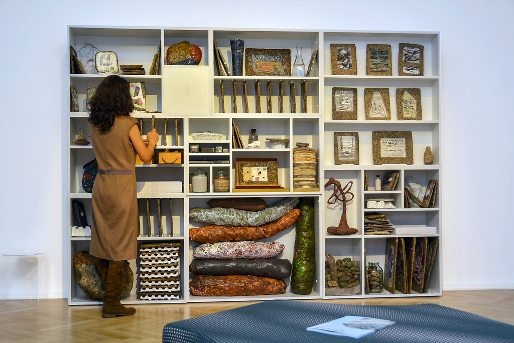 the artist in front of In-Trigâ Bookcase installation at STACKING exhibition, AnnArt Gallery, Bucharest, in 2016