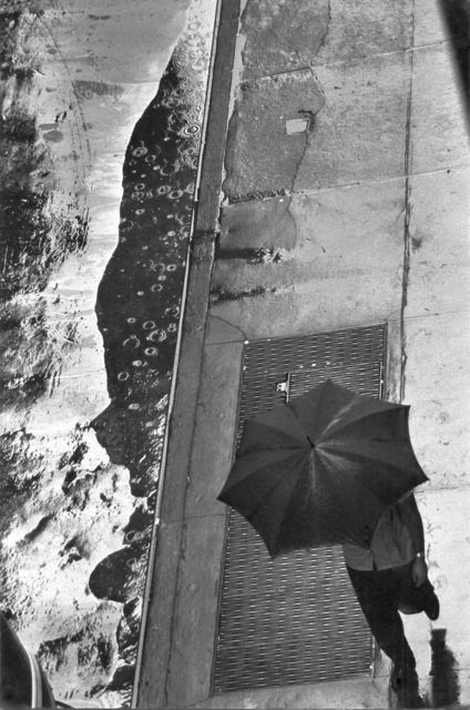 , 'Man with Umbrella, Rain Puddle, from Above, 11 West 22nd Street, NYC,' 1960, Robert Mann Gallery