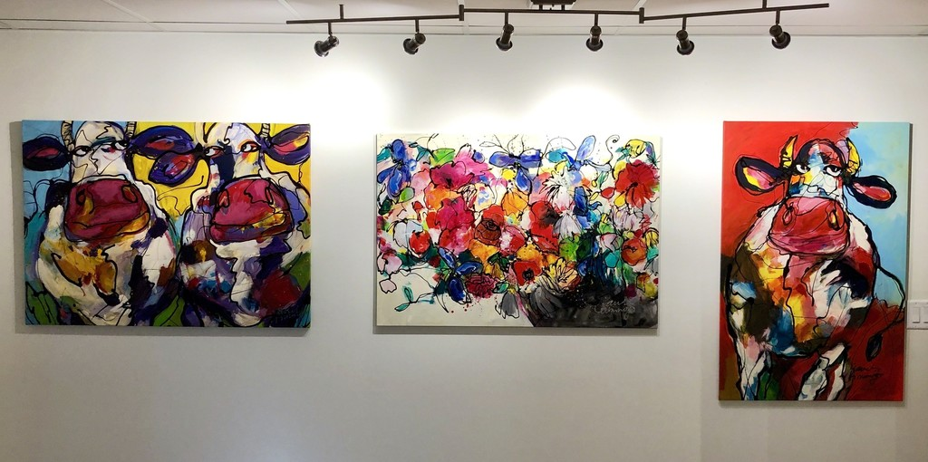 """(from left to right) """"Colourful Cows"""", """"Bunch of Fun"""", and """"Cow in Red"""" by Dutch artist, Janet Timmerije"""