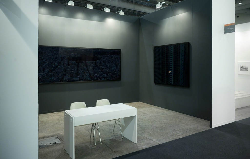 Installation view of Arte Globale booth at ZsONAMACO FOTO (E104) with works by Aristotle Roufanis and Mitra Tabrizian.