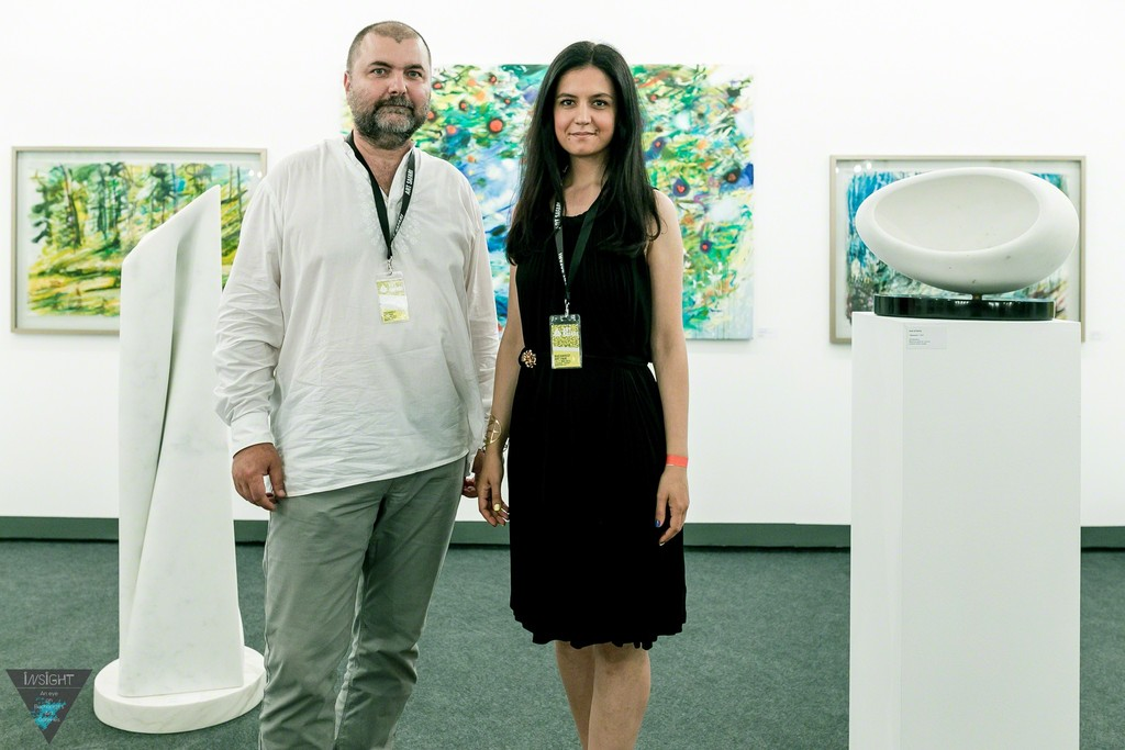 Artfooly Gallery booth at International Contemporary Art Fair Art Safari Bucharest, 2015. Painter Claudiu Presecan, curator Anca Negescu. Painting by Claudiu Presecan, sculpture by Dan Istrate, both Cluj based Romanian artists. Dan Istrate is based in both Cluj, Romania and Carrara, Italy.