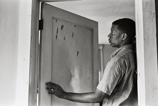 , 'Jerome Smith Inspects Bullet Holes in Door,' 1963, Fahey/Klein Gallery