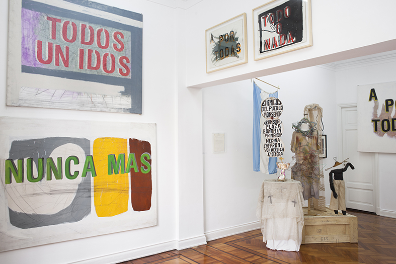 "Exhibition view with works from the series ""Pancartas"" by Gustavo Marrone and installation of costumes and props by Batato Barea."