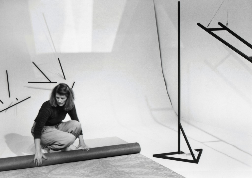 "Photo-documentation of Barbara Kasten installing the exhibition ""Centric 2: Barbara Kasten, Installation/Photographs"", University Art Museum, California State University Long Beach, 1982. Courtesy of the artist and the University Art Museum, California State University Long Beach."
