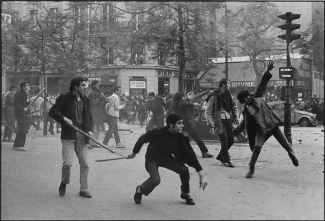 , 'Students hurling projectiles against the police. 6th arrondissement. Boulevard Saint Germain. Paris, France. ,' 1968, Magnum Photos