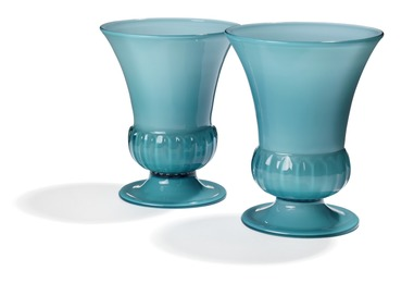 Two vases of light blue glass with white opal glass underlay.