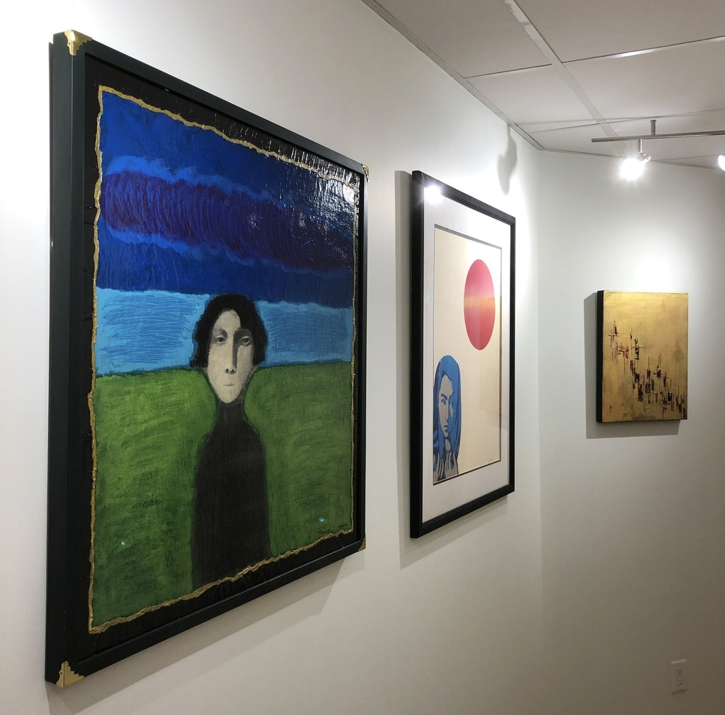 """(from left to right) """"Timeless"""" and """"Luna Roja"""" by San Francisco artist Martín Shulka. """"Voyage of Thoughts No. 03"""" by Swedish artist, Arngrim Larsen"""