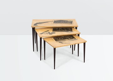 a set of three wooden tables with parchment tops