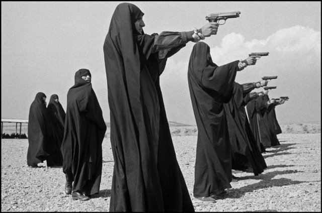 , 'Veiled women practice shooting on the outskirts of the city. Tehran, Iran. ,' 1986, Magnum Photos