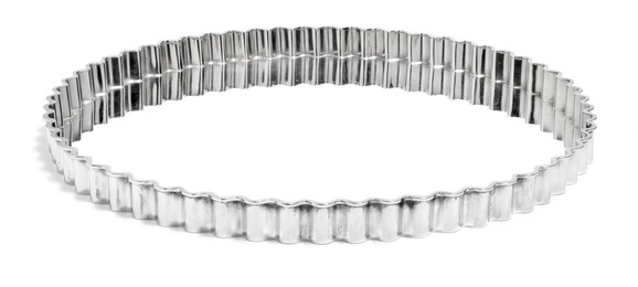 Circular sterling silver serving tray with wavy rim.