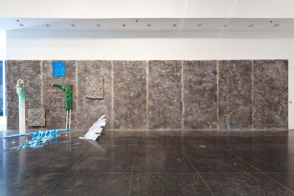 Installation view: Allison Matherly, Rock Slab Wall, Hand carved insulation foam and paint, 384 x 96 inches