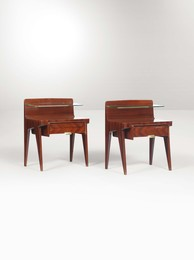 A pair of night tables with a wooden structure, a glass top and brass details