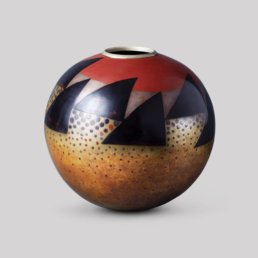 Spherical vase with triangles and dots