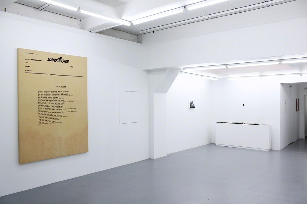 "Installation view at Harlan Levey Projects ""Comes the Dawn"", 2015, graphite, resin, funerary ash, on dyed Muslin, 214 x 152 cm, ""Kirtland"", 2014, graphite, resin, funerary ash, on wood panel, 28 x 35.5 cm, ""I want your Body"", 2013, Bronze, 5.1 cm diameter and ""Crackle & Drag Zine Set"", 2013, 150 zines and plexi box, 19.5 x 16.2 x 15.2 cm."