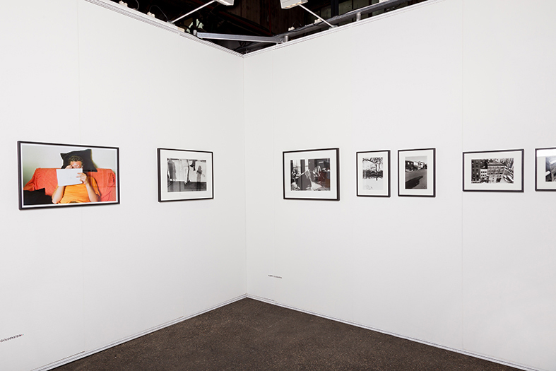 Booth View. Alberto Goldenstein with portrait of Jorge Gumier Maier and photographs of the series Boston 1982-1983.