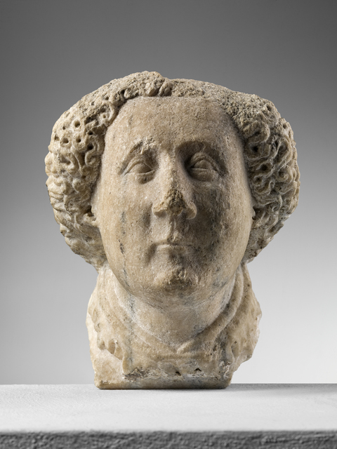 , 'Corbel depicting the head of a young man,' 1410-1420, Brun Fine Art