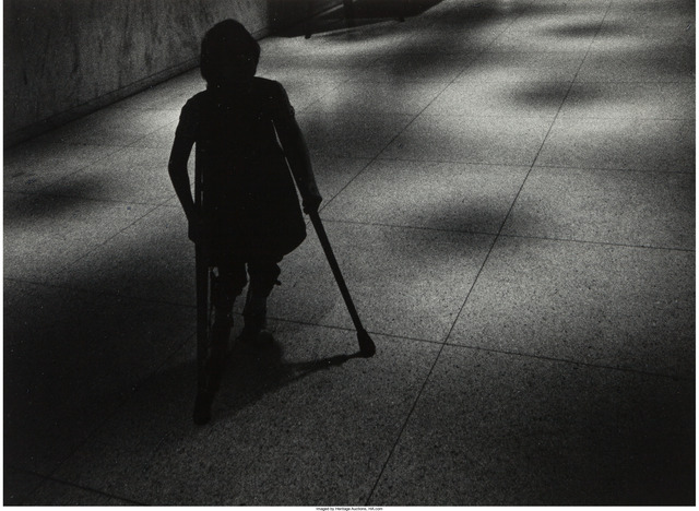 W. Eugene Smith, 'Silhouetted girl on crutches walking down hospital hall', circa 1966-68, Heritage Auctions