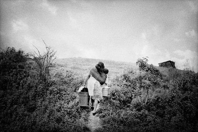 , 'A mother returns home. San Miguel Cuevas, Mexico.,' 2000, Anastasia Photo