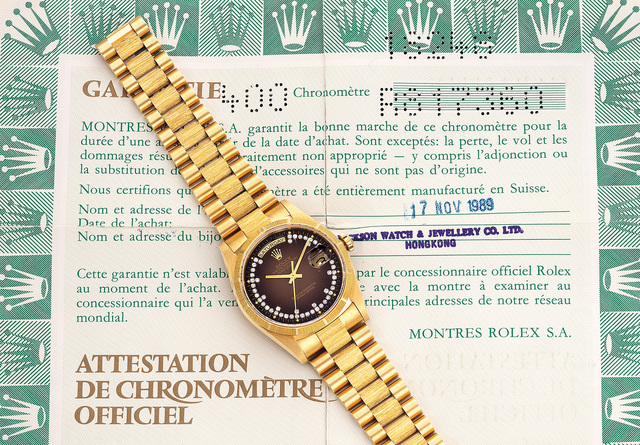 Rolex, 'A fine and attractive yellow gold and diamond-set wristwatch with day, date, brown dégradé dial, bracelet and guarantee', 1989, Phillips