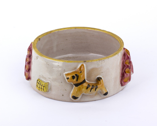 Bowl with puppies and relief decorations