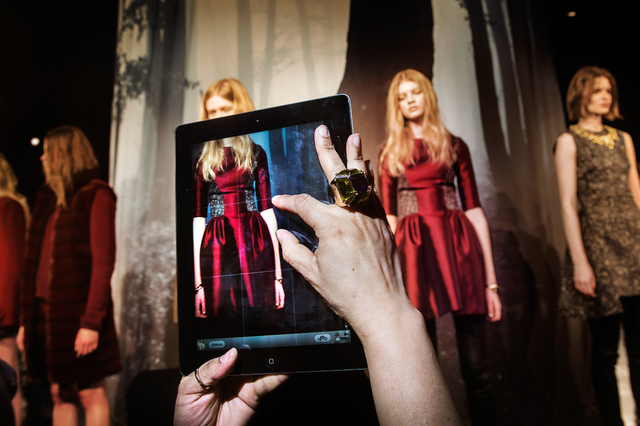 , 'A guest takes an iPad photo of the models during the ADEAM presentation at Lincoln Center . Mercedes-Benz Fashion Week, New York City, Fall 2013.,' 2013, Anastasia Photo