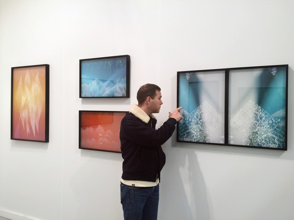 Artist Christopher Russell with works on view during AIPAD.