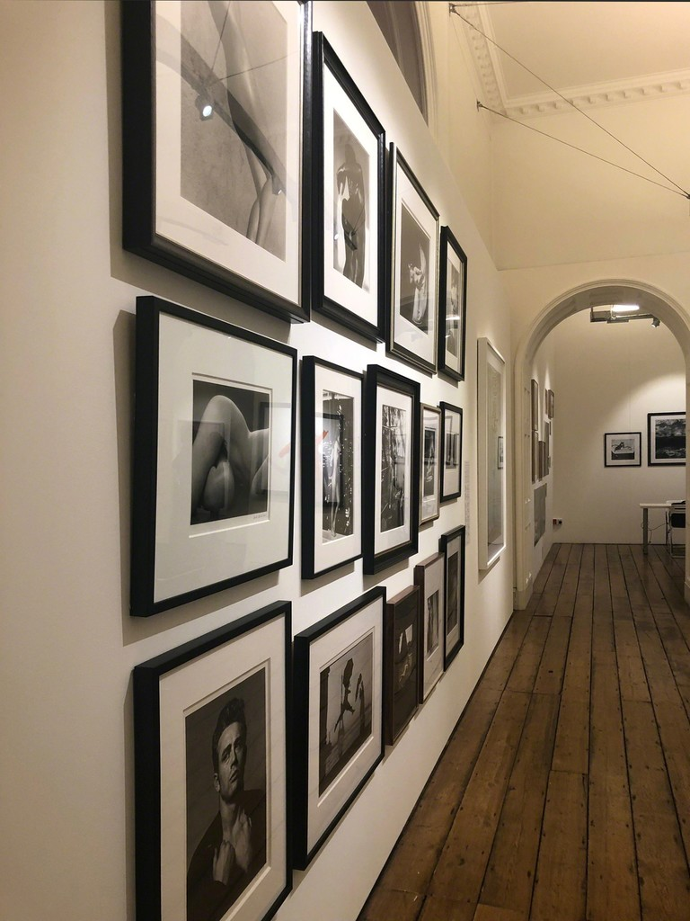Holden Luntz Gallery salon style wall including work by Barbara Morgan, Helmut Newton, Herb Ritts, Roy Schatt and Ruth Bernhard - Photo London 2019