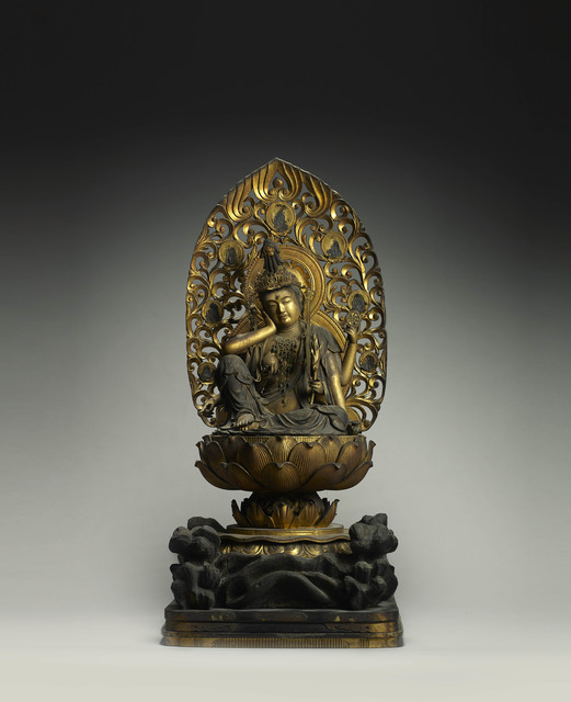 , 'Nyoirin Kannon (The Bodhisattva who grants desires) with six hands and various attributes seated in the posture of royal ease and contemplation on a lotus throne with a reticulated mandorla,' Japan 13th/14th century Kamakura period, Gregg Baker Asian Art