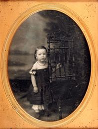 Group of three portrait daguerreotypes of children