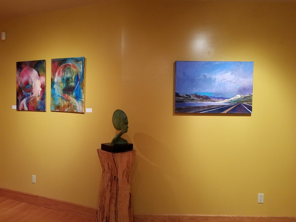 On left Hostetler oils, IKON XVI and IKON XV, IKON bronze and Sherre Wilson Liljegren's Toward Yellow Stone