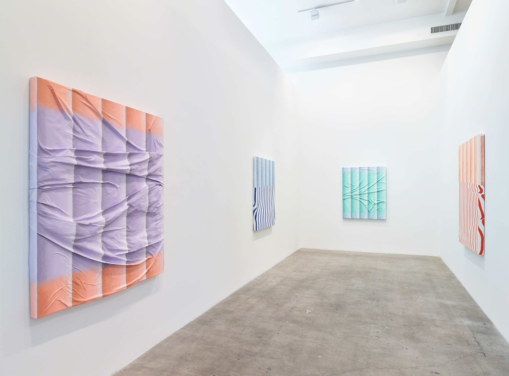 "Installation view of ""Transfigured."" with paintings by Sarah Mikenis"