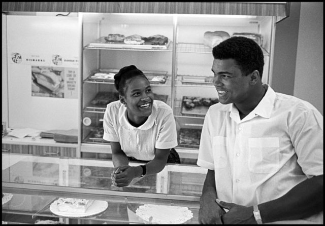 , 'Muhammad Ali flirts with Belinda Boyd in a bakery shop. Belinda later became Ali's second wife as Khalilah Ali, Chicago,' 1966, Atlas Gallery
