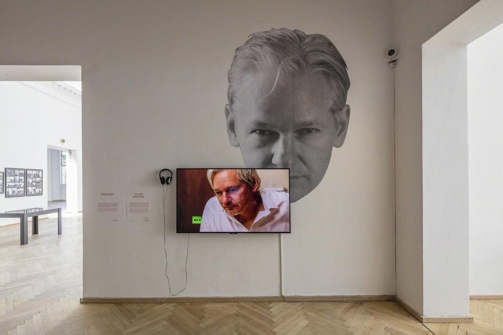 "Julian Assange, ""The World Tomorrow: Slavoj Zizek & David Horowitz"". Video, 28:00 min. Installation view from 'Whistleblowers & Vigilantes, Kunsthal Charlottenborg, 2017. Photo by Anders Sune Berg."