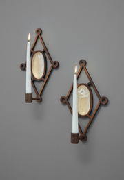Unique pair of wall-mounted candle holders