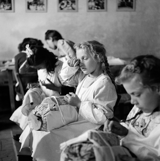 ", '""Tired Eyes"". Orphans in a sewing class, Trieste, Italy, 1947 ,' 1947, Monroe Gallery of Photography"