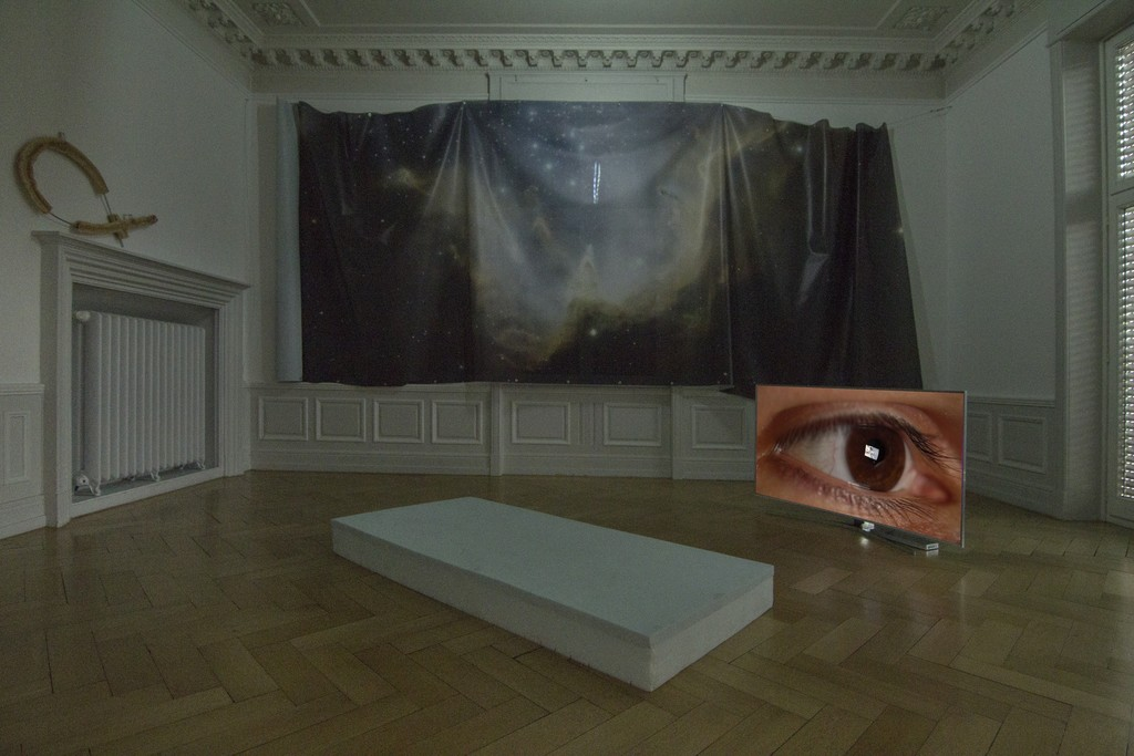 Installation View (from left to right): Countdown Belladonna, Bread I, bread dough on custom shaped aluminum rod, 100x58cm, 2016 Countdown Belladonna, Nebula I (N90), digital print on mesh,size variable, 2016 Countdown Belladonna, Florian, 4k single channel video, 1:22h, 2016