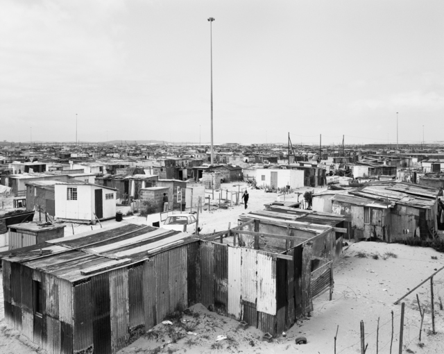 David Goldblatt, 'Flushing Meadows and lightning masts, Site B, Khayelitsha, Cape Town, 11 October 1987', 1987, Goodman Gallery