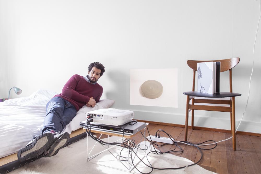 Portrait of host, in the background work by Aloïs Godinat