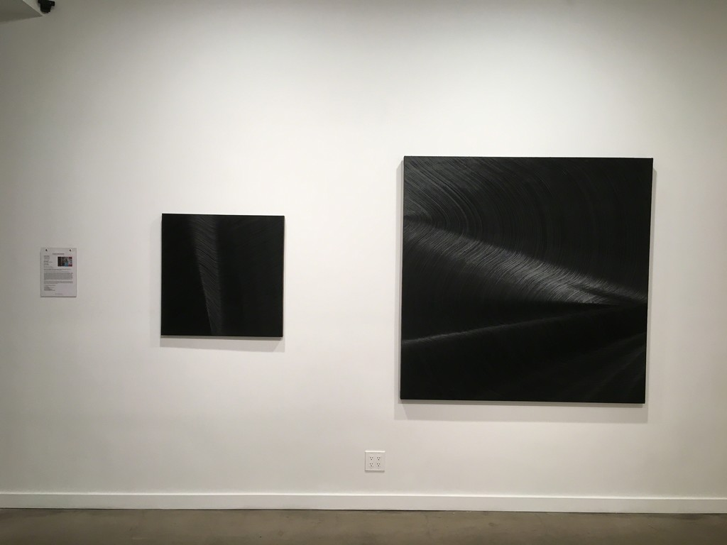 "James Austin Murray ""3 Parsecs Later"" (left) and ""Limiting Factor"" (right), ivory black oil paint on canvas"
