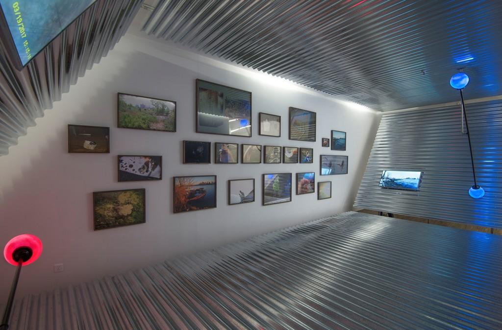 Parallel Tetrahedron: Metal, wood, video, sound, lights, inkjet prints on paper 1090 × 460 × 400 cm 2017