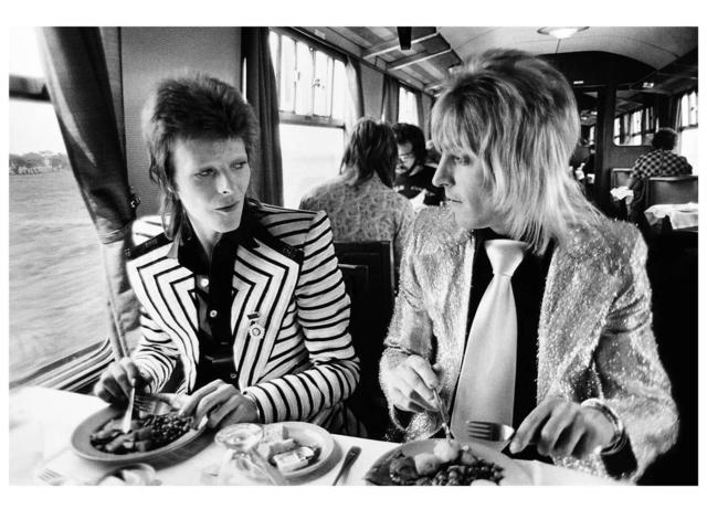 Mick Rock, 'David Bowie and Ronson. Lunch on train to Aberdeen', 1973, The Bonnier Gallery